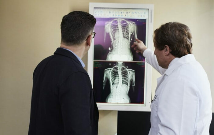 Doctor pointing to chest radiograph