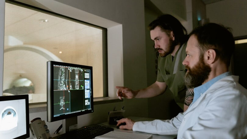 Doctors looking at medical images